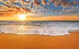 Fototapety Colorful ocean beach sunrise.