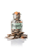 property on clear glass jar with money.
