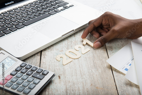 Poster Hand arranging financial year 2021