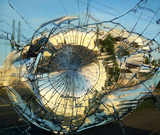 Broken mirror glass in which is reflected the city. Horizontal. - 104356848