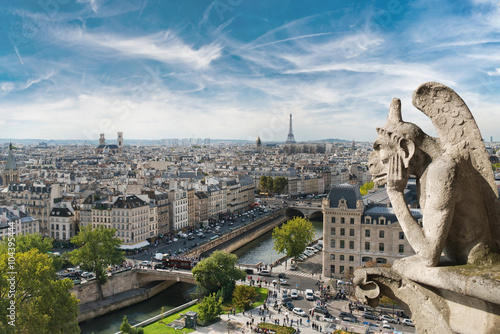 Poster Gargoyle and wide city view from the roof of Notre Dame de Paris