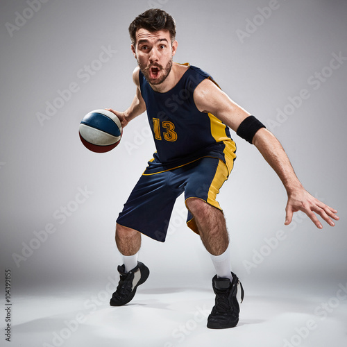 Poster Full length portrait of a basketball player with ball