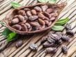 Cocao pod and cocao beans on the wooden table.