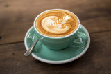 hot cappuccino with latte art on wood background - 104426865