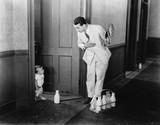 Milkman greeting baby at door  - 104428828