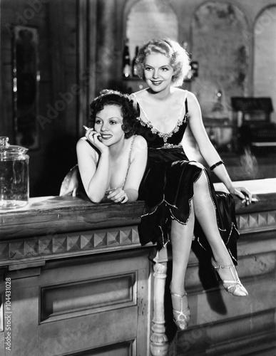 Portrait of two women smoking on bar  - 104431028