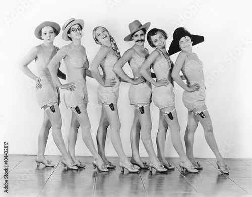 Women standing in a chorus line in lingerie  Poster