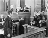 Lawyer and a witness in a courtroom  - 104433025