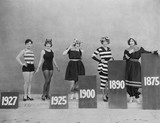 Women wearing fashions of different eras  - 104441060