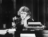 Confused woman on telephone  - 104444055