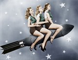 Three women sitting on a rocket   - 104444211