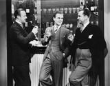 Businessmen drinking together at bar  - 104447452