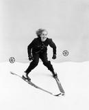 Female skier skiing downhill  - 104447642