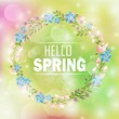 Circle floral frame with text hello spring and bokeh background