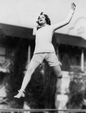 Jumping woman in midair  - 104448491