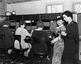 Telephone operators at switchboard  - 104451018
