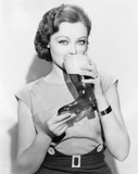 Woman drinking beer out of a boot shaped glass  - 104451291