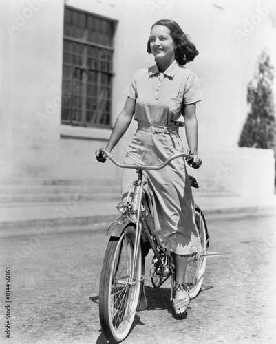 Young woman riding her bike  - 104456063