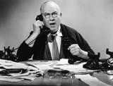 Businessman using multiple phones  - 104459069