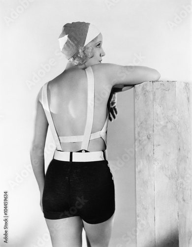 Rear view of woman in bathing suit  - 104459634