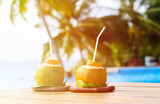 two coconut drinks served in luxury resort - 104473694