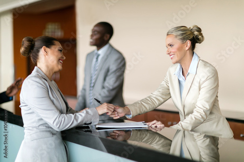 businesswoman at hotel reception