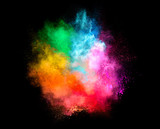 Fototapety Colorful Dust Particle Explosion Isolated on Black Background
