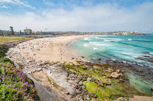 Bondi Beach, Sydney, Australia - OCT 25, 2014: Tourists and swimmers relaxing on