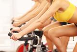 Fototapety Sporty women on spinning class
