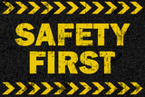 Safety first word on grunge background - 104653071