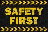 Safety first word on grunge background - 104653071