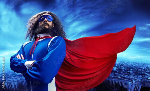 Foto op Plexiglas Artist KB Portrait of a superheroe posing over the urban landscape