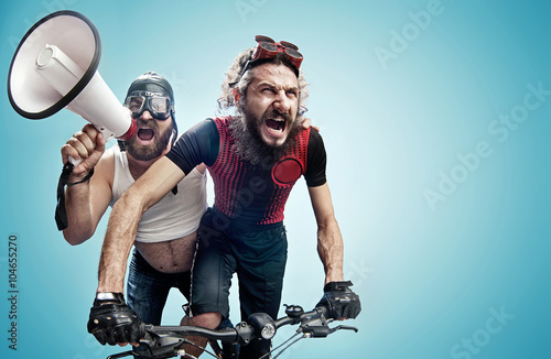 Two hilarious cyclists involved in a contest