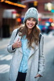 Fototapety Beautiful smiling woman walking on the New York City street wearing casual style clothes