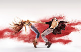 Fototapety Talented young dancers sprinkling red dust