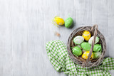 Fototapety Colorful easter eggs in basket