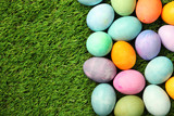 Fototapety Colorful Easter eggs on grass background