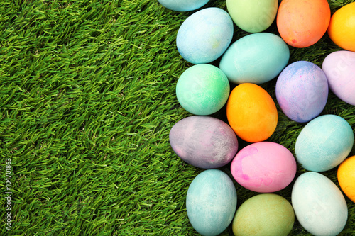 Colorful Easter eggs on grass background Poster