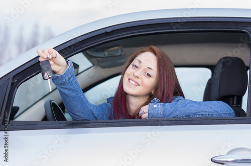 Attractive caucasian girl holding keys of her car - people, lifestyle and traspo Poster