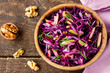 salad of red cabbage, apples and walnuts - 104745821