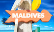 Maldives direction sign with beach