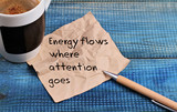 Inspiration motivation quotation Energy flows where attention goes and cup of coffee