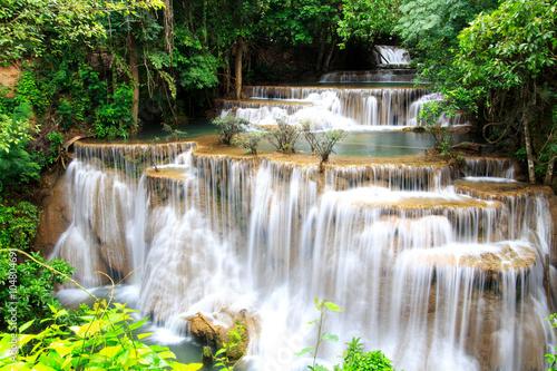 Plakat Huai Mae Khamin waterfall in deep forest Thailand.