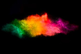 Fototapety Color Explosion. Dust Particle Isolated on Black Background