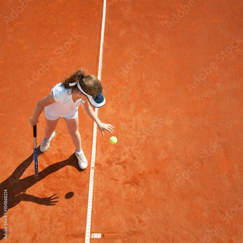Little tennis champion preparing to serve