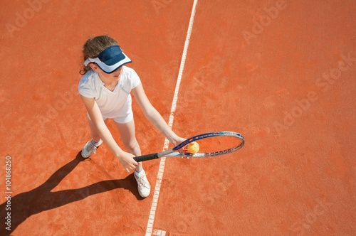 Young tennis champion preparing to serve