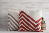Two Front-Facing Throw Pillows with Chevron Design