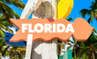 Florida sign with palm trees on background