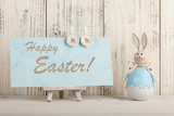 Fototapety Easter bunny and greeting for Easter holiday