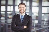 Happy businessman with arms crossed